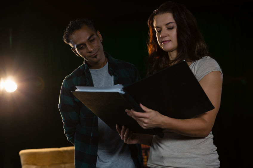 Photo - Two actors read a script